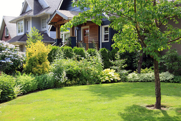 Beautiful home surrounded by a lush perennial front garden.
